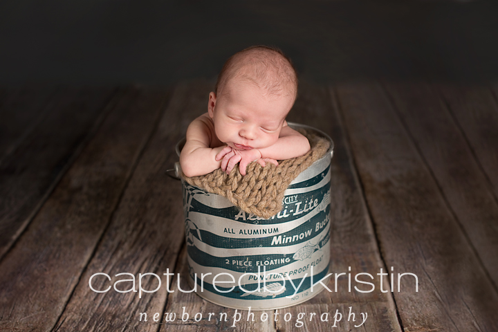 Guelph newborn photographer takes pictures of baby in bucket